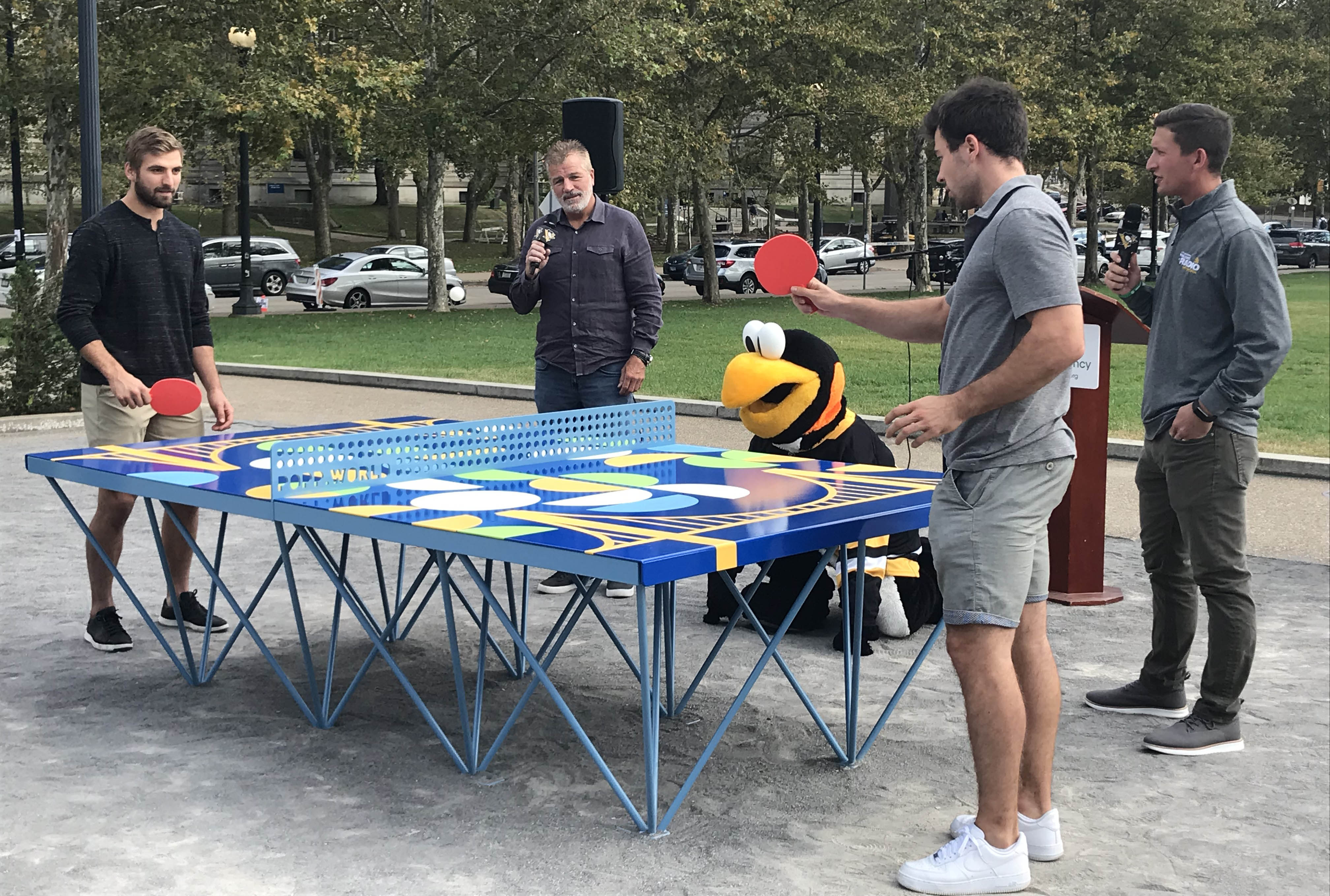 Penguins players at ping pong table