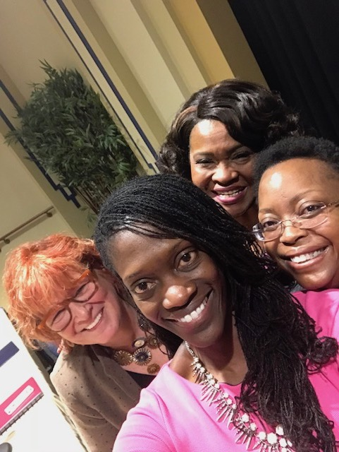Moderator Valerie Kinloch poses for a selfie with panel members Patricia Beeson, Kathy Humphrey and Geovette Washington.